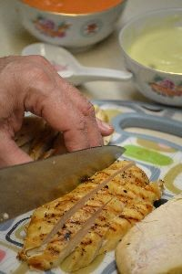 slicing the chicken into long strips_small