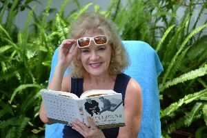Julie Reading backyard ferns