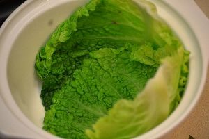 once you pat the cabbage dry you want to arrange the cabbage leaves into your casserole dish_small