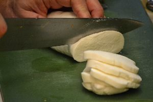 slicing the mozzarella into chunks_small