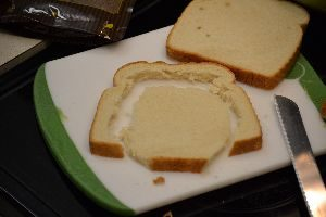 trying to cut an oval shape out of a slice of bread_small