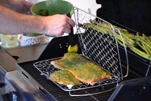 Gordon adding the pesto to the salmon_small