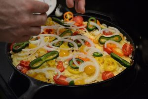 adding the pablamo peppers and onions_small