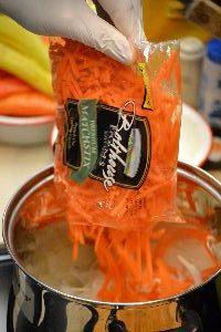 adding the already sliced carrots_small