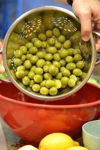 13 adding the olives to a large bowl_small
